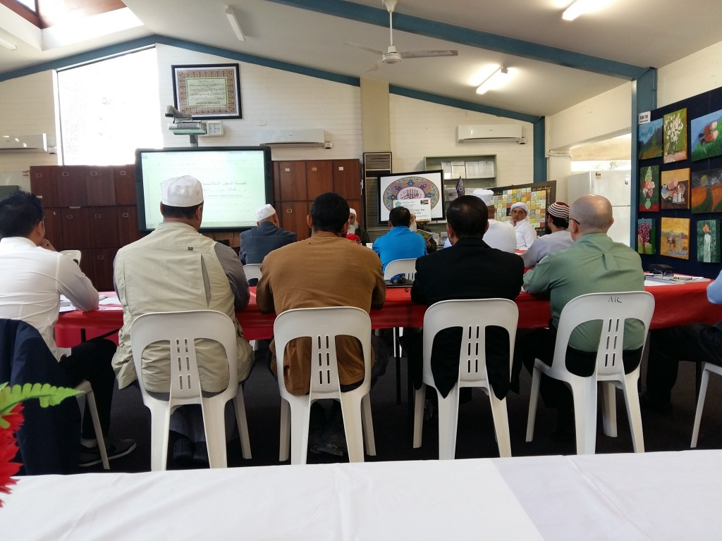 Members of police and Imams at the workshop.