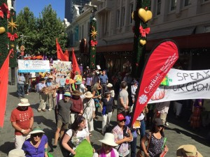 People marching up Hay St Street.
